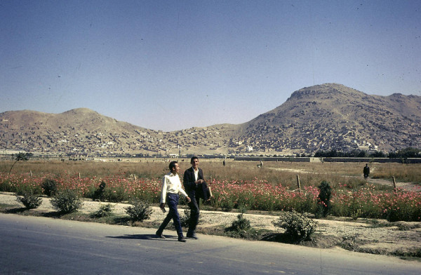 Young Afghans walking home.